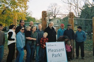 The West 7th-Smith Task Force and Pleasant Park artists pose for photo at the park dedication.